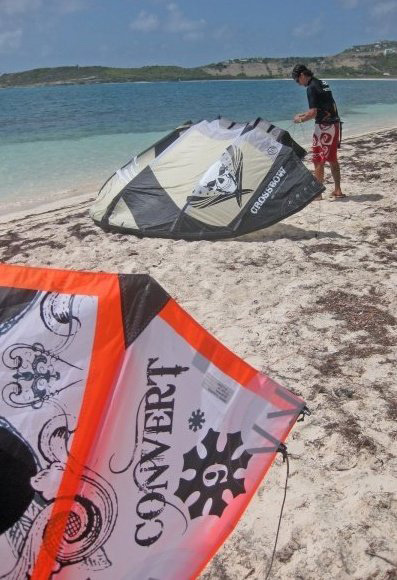 The number of kites you need is dependent on the conditions at your local beach. Ideally, you should have 3 kites: a light wind kite (5 to 15 knots), a moderate wind kite (10 to 20 knots), a high wind kite (15 to 30 knots). For an typical kiter, this means a quiver consisting of 18m, 12m and 8m inflatables. Most kitersurfers doesn't go out in wind less than 12 knots and therefore can be satisfied with only 2 kites. For such kiters, this means a quiver consisting of a 16m and a 10m inflatables.